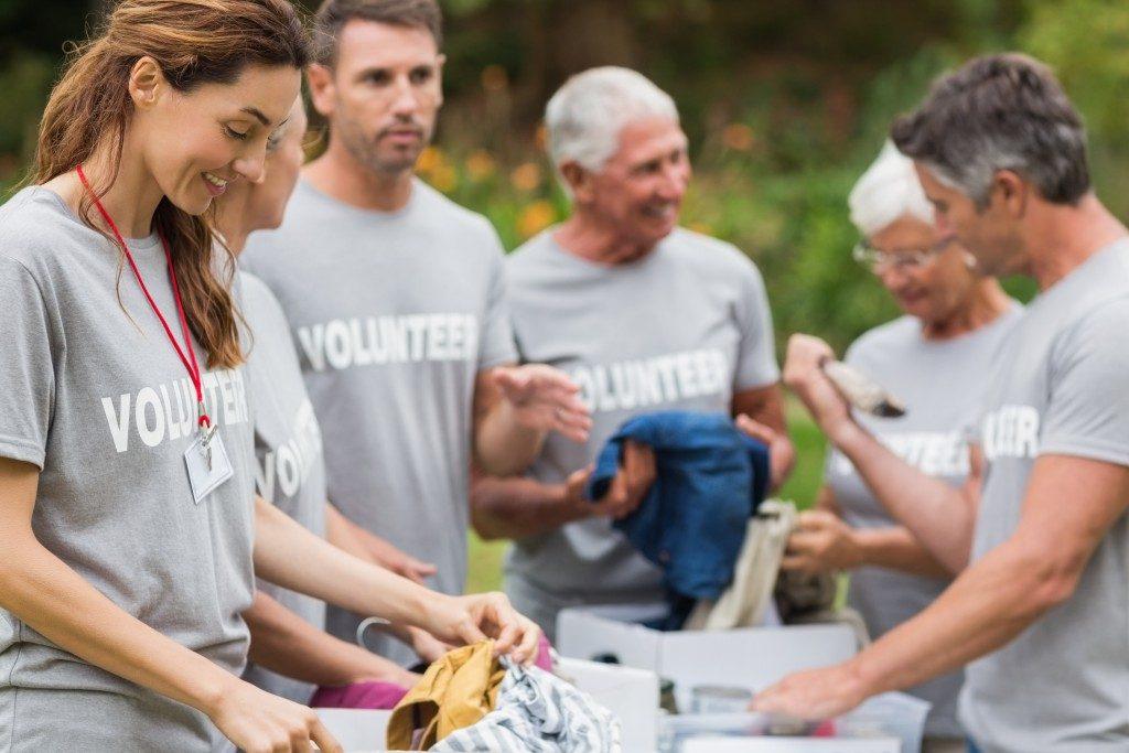volunteer looking at donation box