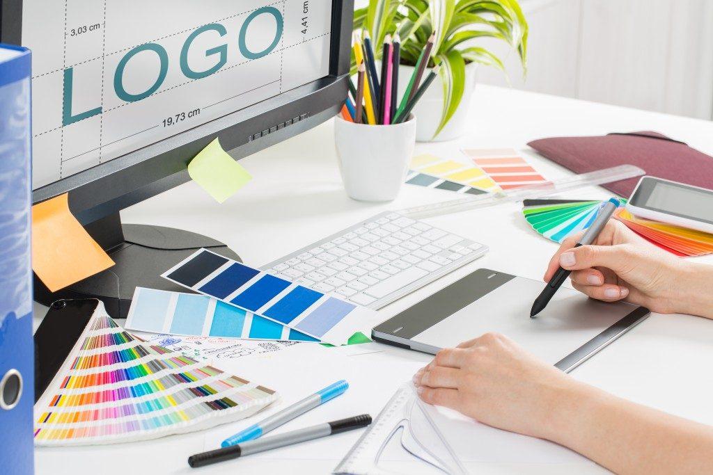 Graphic artist designing a brand's logo