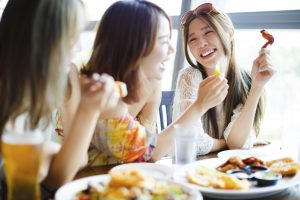 Group of friends having fun while eating